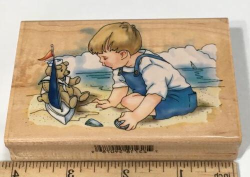 rubber stamp boy on beach teddy boat